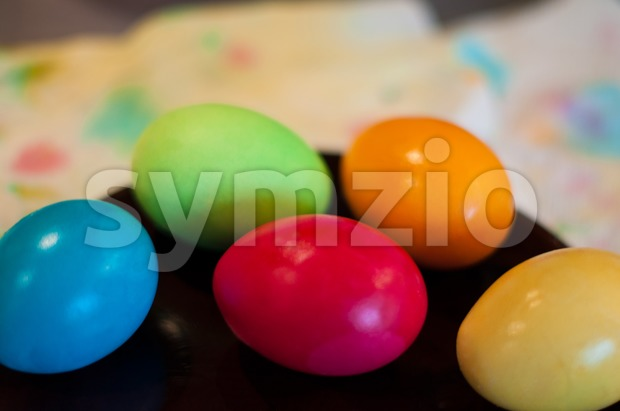 Close-up of coloured easter eggs on a plate