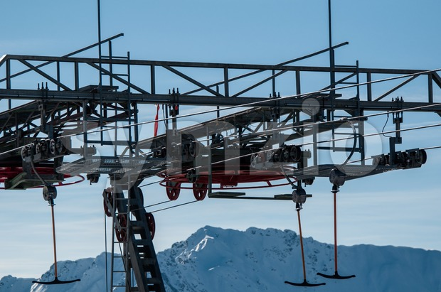 Detail of T-bar ski lift (drag lift) against great bkue sky