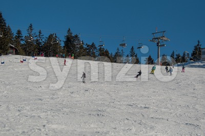 Skier and snowboarder on skiing slope Stock Photo