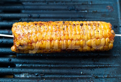 Roasted corn on the cob Stock Photo