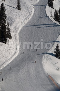 Snow covered ski piste Stock Photo