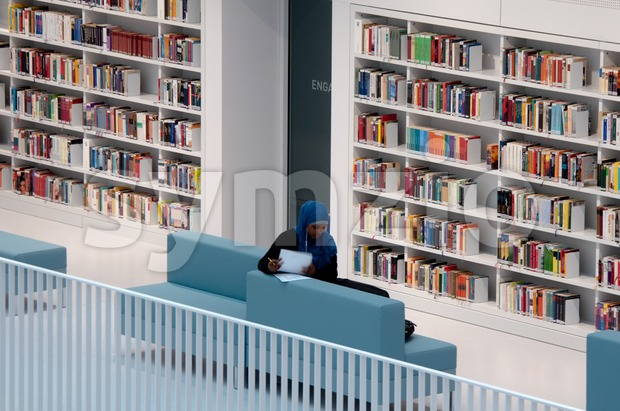 STUTTGART, GERMANY – MAY 5: The new municipal public library is used by a young Muslim woman  for studying ...
