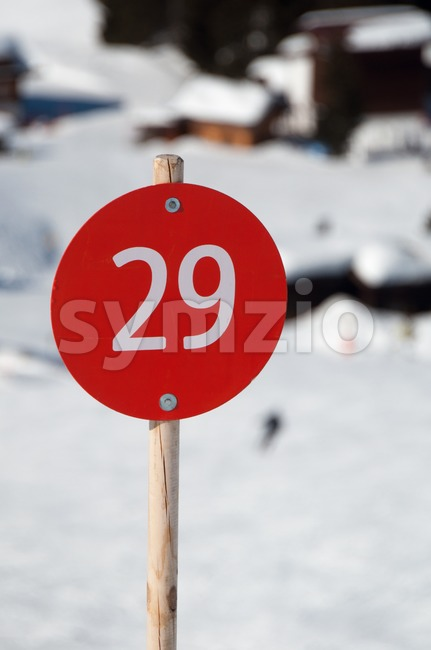 Number 29 on red sign next to ski slope in Montafon, Austria