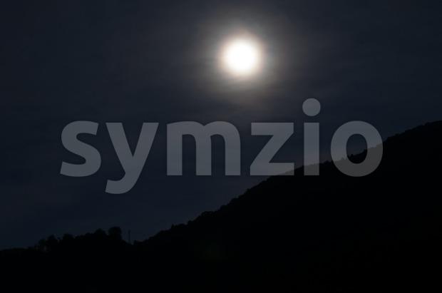 Moon over mountains Stock Photo