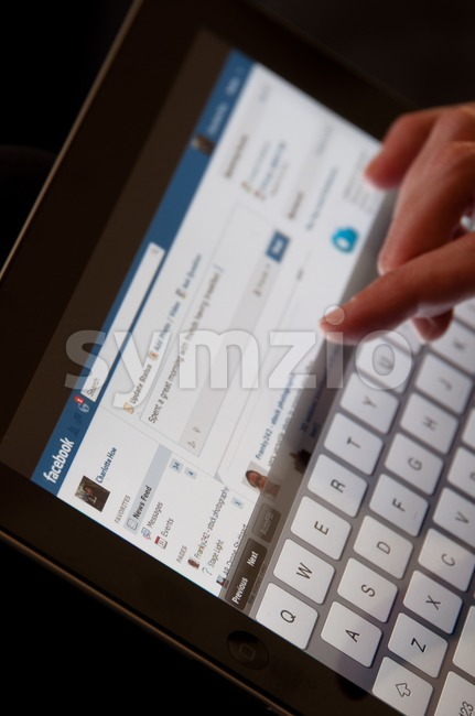 Apple iPad with Facebook Website Stock Photo