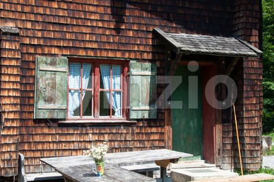 Idyllic Alpine Cottage Stock Photo