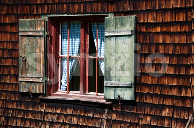Idyllic Alpine Cottage Window Stock Photo