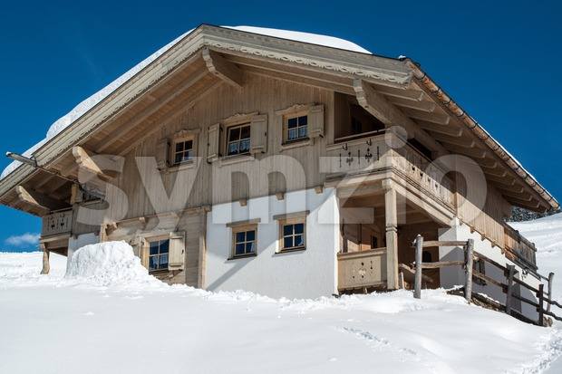 Beautiful skiing hut in a valley of Montafon, photo taken from public skiing piste