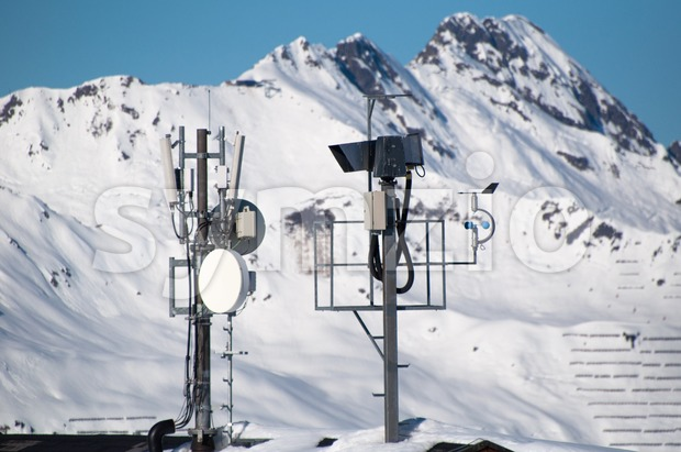 Communication tower with lifecam, satellite dishes and aerials in skiing resort in Montafon, Austria
