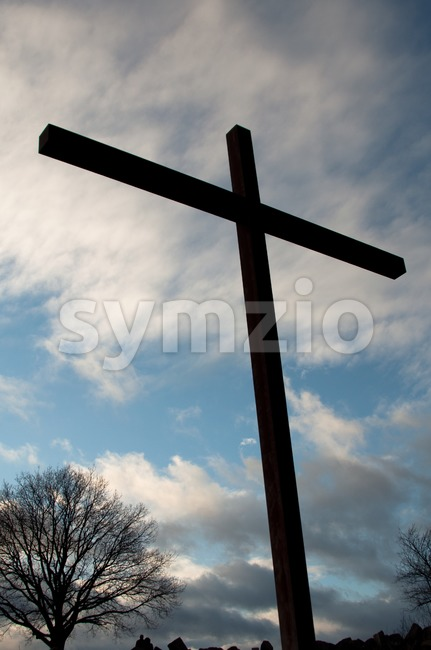 Large Cross Over Sky With Clouds Stock Photo