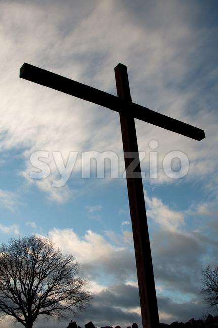 Large cross against great cloudy winter sky on Birkenkopf mountain in Stuttgart, Germany