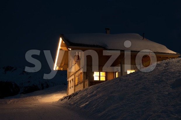 Beautiful skiing hut at night in a valley of Montafon, photo taken from public skiing piste