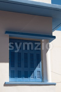 Greek blue window shutters Stock Photo