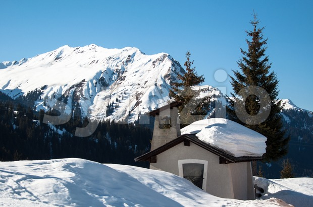 Small chapel in skiing resort in the mountains of Montafon, Austria