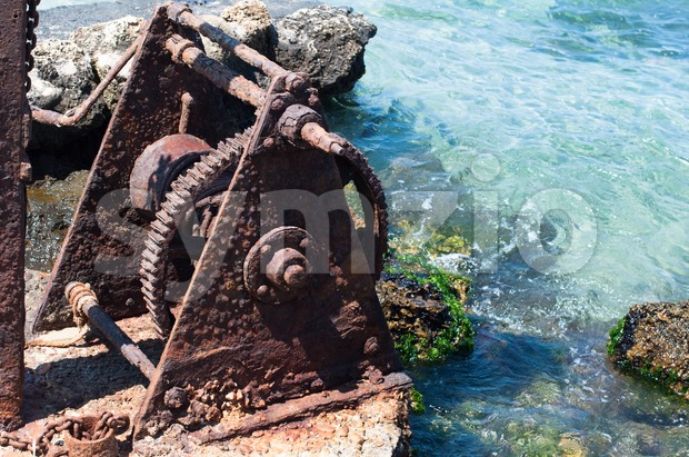 Old Winch at the Harbour Stock Photo