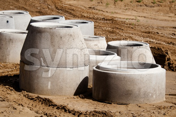 Concrete drainage pipes on a construction site for a highway extension