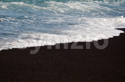 Black volcanic sand beach Stock Photo