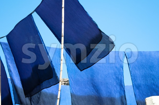 Scarves drying in the sun Stock Photo