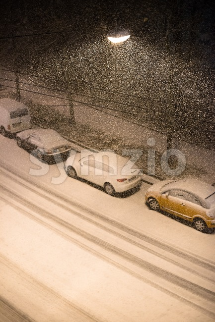 Cars parked in snow Stock Photo