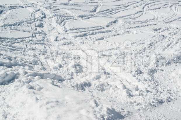 Ski tracks in fresh powder snow - skiing background
