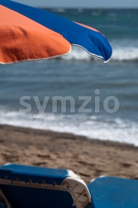 Sunchair And Umbrella On The Beach Stock Photo