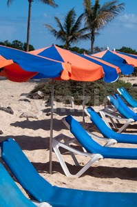 Sunchairs And Umbrellas On The Beach Stock Photo