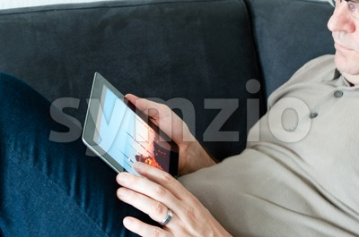 Middle-aged man with digital tablet pc Stock Photo