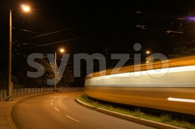 Tram at night Stock Photo